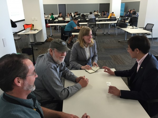"Mayor Hisamoto learning more about the ""Hackathon"" project at San Francisco International Airport"