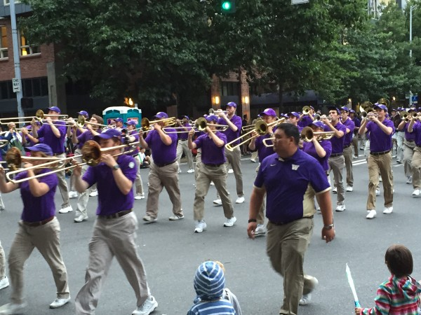 University of Washington marching band providing entertainment during the Torchlight Parade